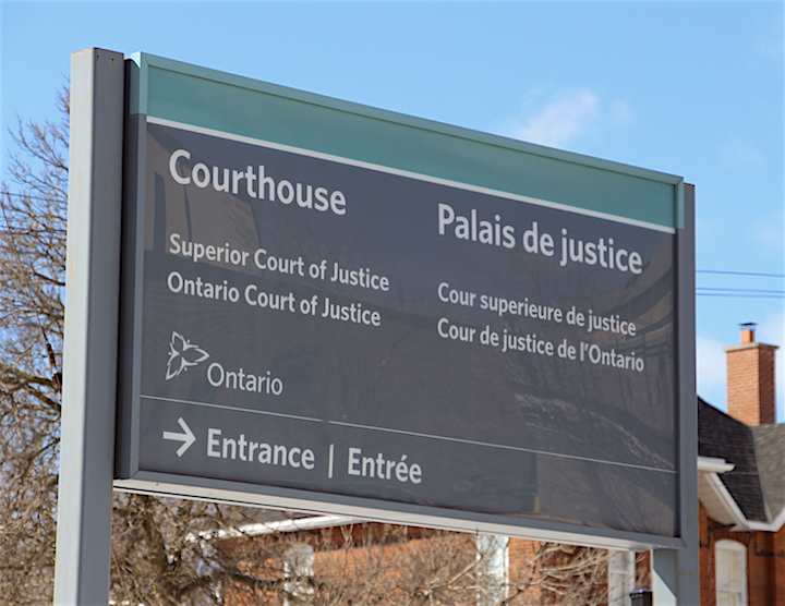 An exterior Ontario courthouse entrance sign.