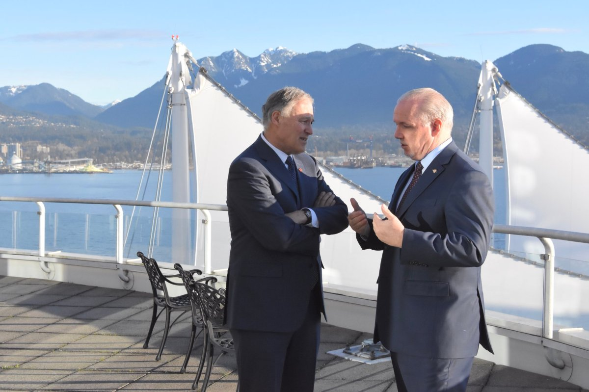 Washington State Governor Jay Inslee with B.C. Premier John Horgan in Vancouver on March 16.