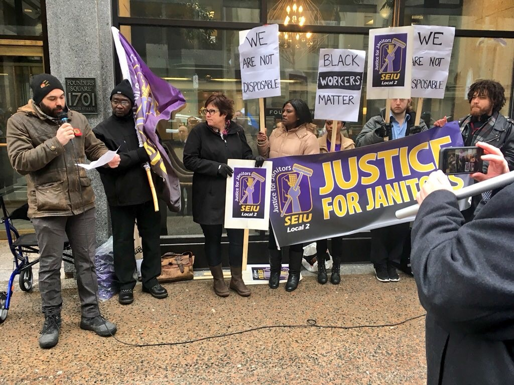 SEIU Local 2 members set to lose their cleaning jobs protested with their supporters in front of Founders Square Halifax on March 23, 2018.
