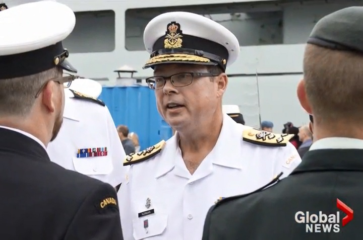 Vice-Admiral Mark Norman has been charged with breach of trust over an alleged shipbuilding leak.