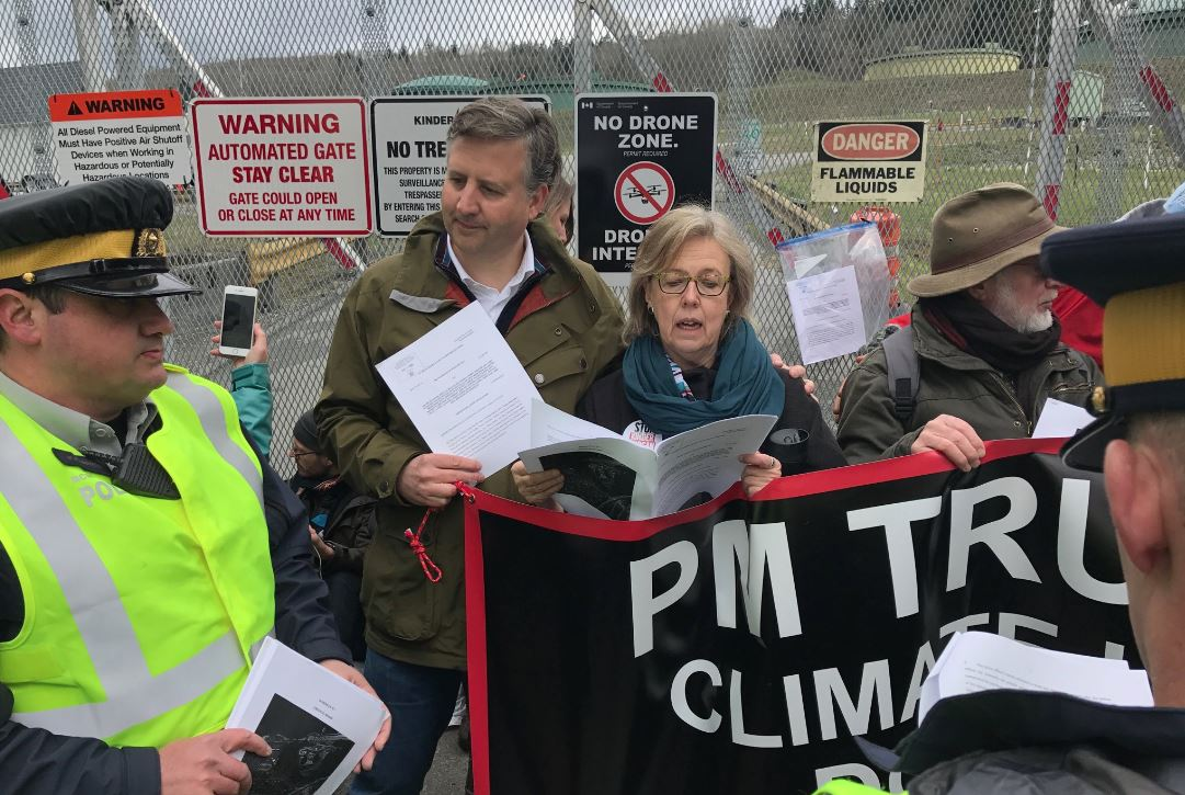 MPs Elizabeth May and Kennedy Stewart join protesters at Kinder Morgan facility.