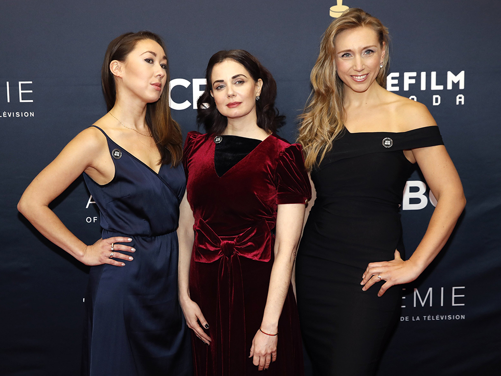 Aisling Chin-Yee, Mia Kirshner and Freya Ravensbergen (L-R), founders of #AfterMeToo, arrive to attend the Canadian Screen Awards in Toronto, Ontario, Canada, March 11, 2018.