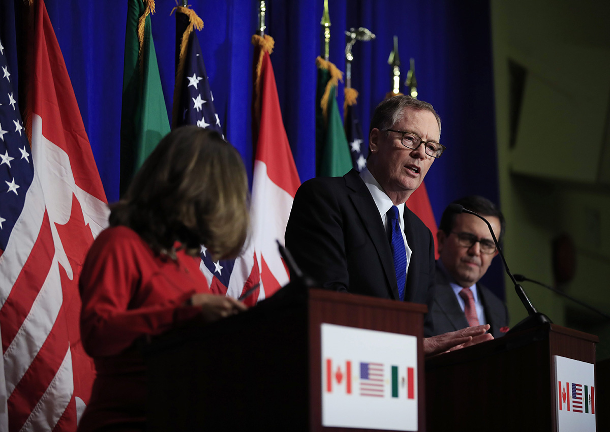 In this Oct. 17, 2017, file photo, U.S. Trade Representative Robert Lighthizer, centre, speaks during the conclusion of the fourth round of negotiations for a new North American Free Trade Agreement (NAFTA) in Washington.