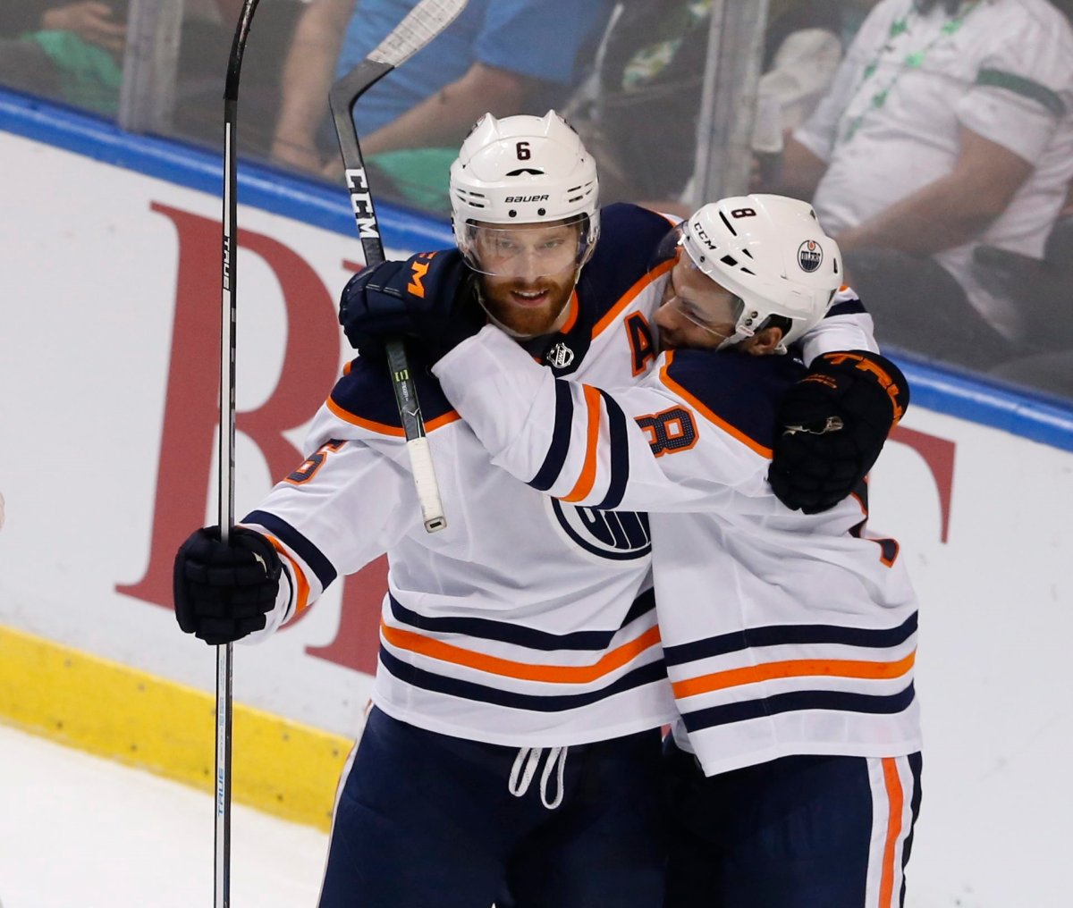 Edmonton Oilers defenseman Adam Larsson (6) celebrates his game-winning goal in the third period with teammate Ty Rattie (8) over the Florida Panthers during an NHL hockey game, Saturday, March 17, 2018, in Sunrise, Fla. The Oilers won the game 4-2.