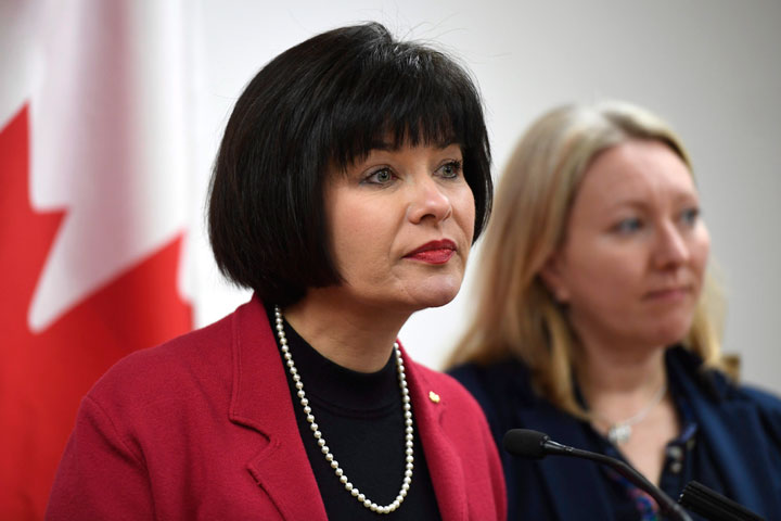 Minister of Health Ginette Petitpas Taylor listens to a question during an announcement on funding for the opioid crisis, as Liberal MP for Ottawa-Vanier Mona Fortier looks on, in Ottawa on Monday, March 26, 2018.