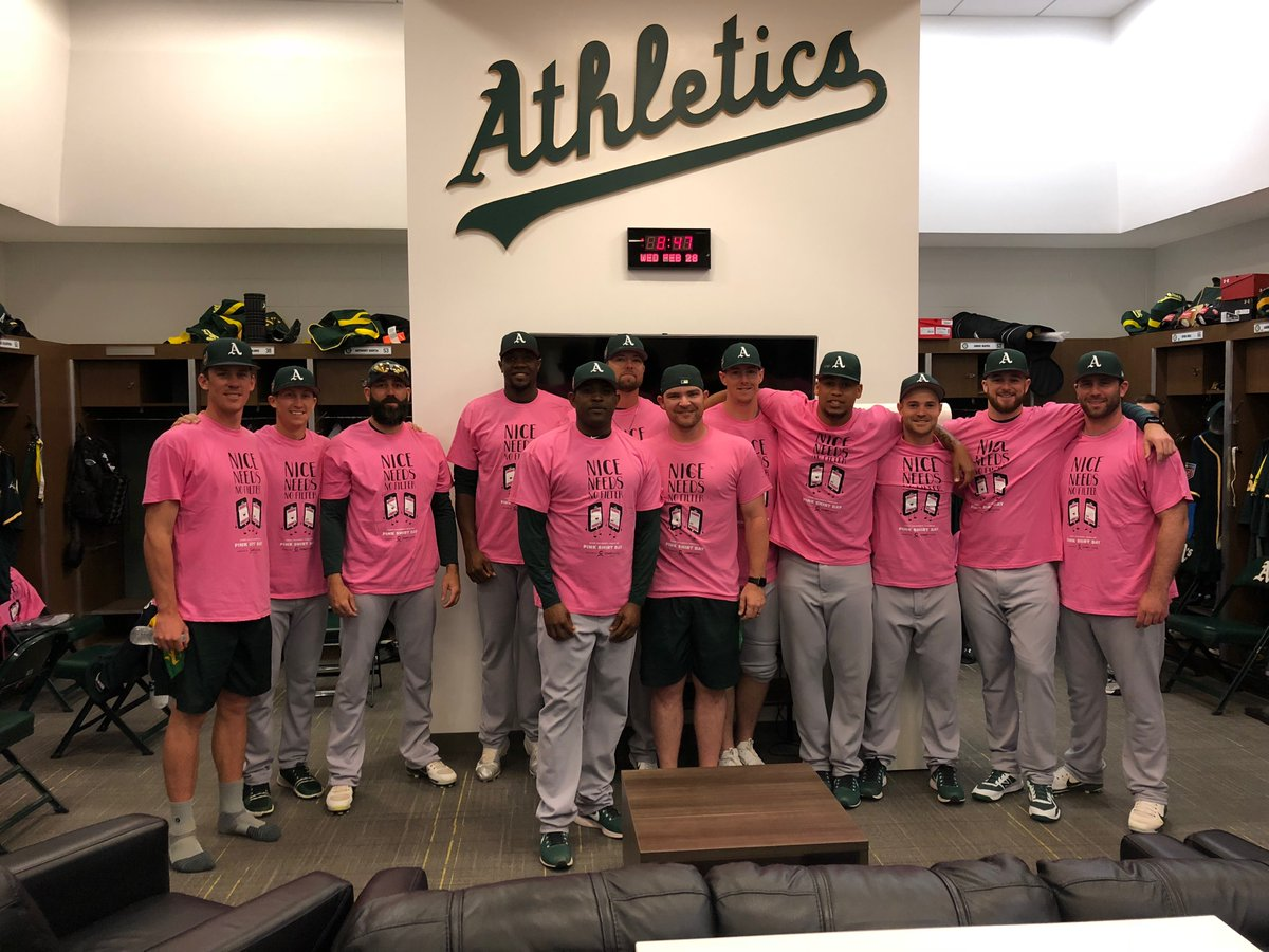 """Players with the MLB Oakland Athletics donned """"Nice needs no filter"""" shirts in support of Pink Shird Day on Wednesday."""