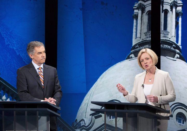 Alberta Progressive Conservative leader Jim Prentice listens to NDP leader Rachel Notley speak during the leaders debate in Edmonton on Thursday April 23, 2015.