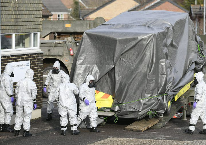 Members of the armed forces in protective suits remove an ambulance from the Salisbury ambulance station in Salisbury, Britain.