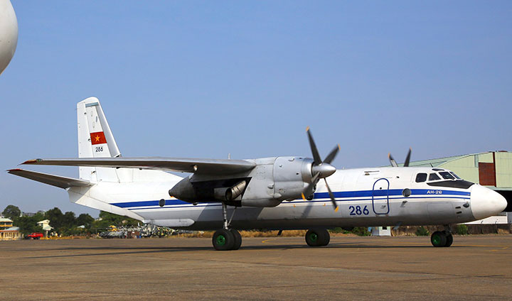 In this file photo dated Sunday, 9 March 2014, a Vietnamese air force aircraft AN-26 is seen at a base in Ho Chi Minh City, Vietnam. Russia's Defense Ministry says an AN-26 Russian military cargo plane of the same type has crashed in Syria, killing 32 people onboard.
