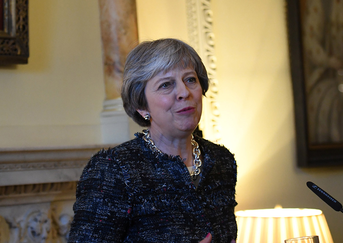 British Prime Minister Theresa May speaks during a reception at Downing Street on March 8, 2018 in London, England.
