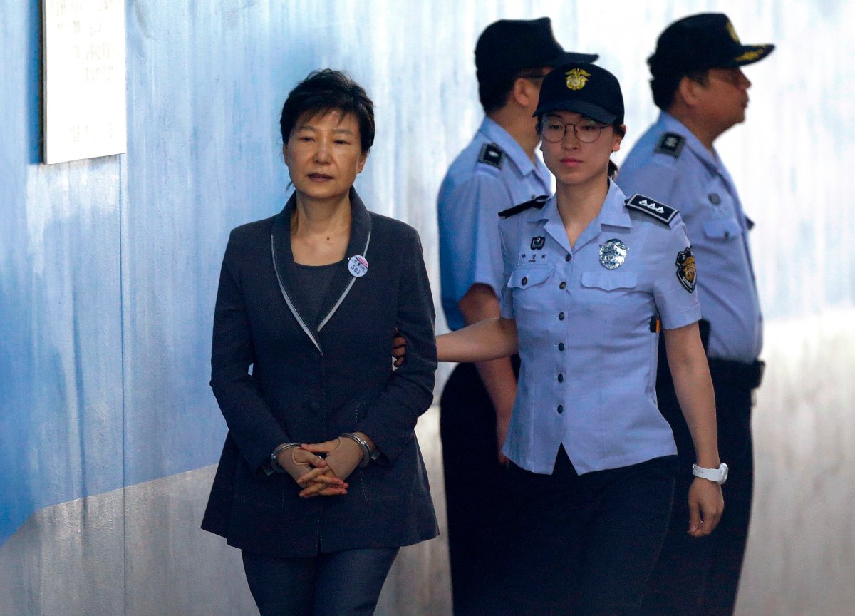 FILE - In this Aug. 7, 2017, file photo, former South Korean President Park Geun-hye, left, arrives for her trial at the Seoul Central District Court in Seoul.