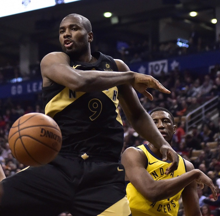 Toronto Raptors forward Serge Ibaka (9) reacts after slamming home a dunk against the Indiana Pacers during first half NBA basketball action in Toronto on Friday, April 6, 2018.