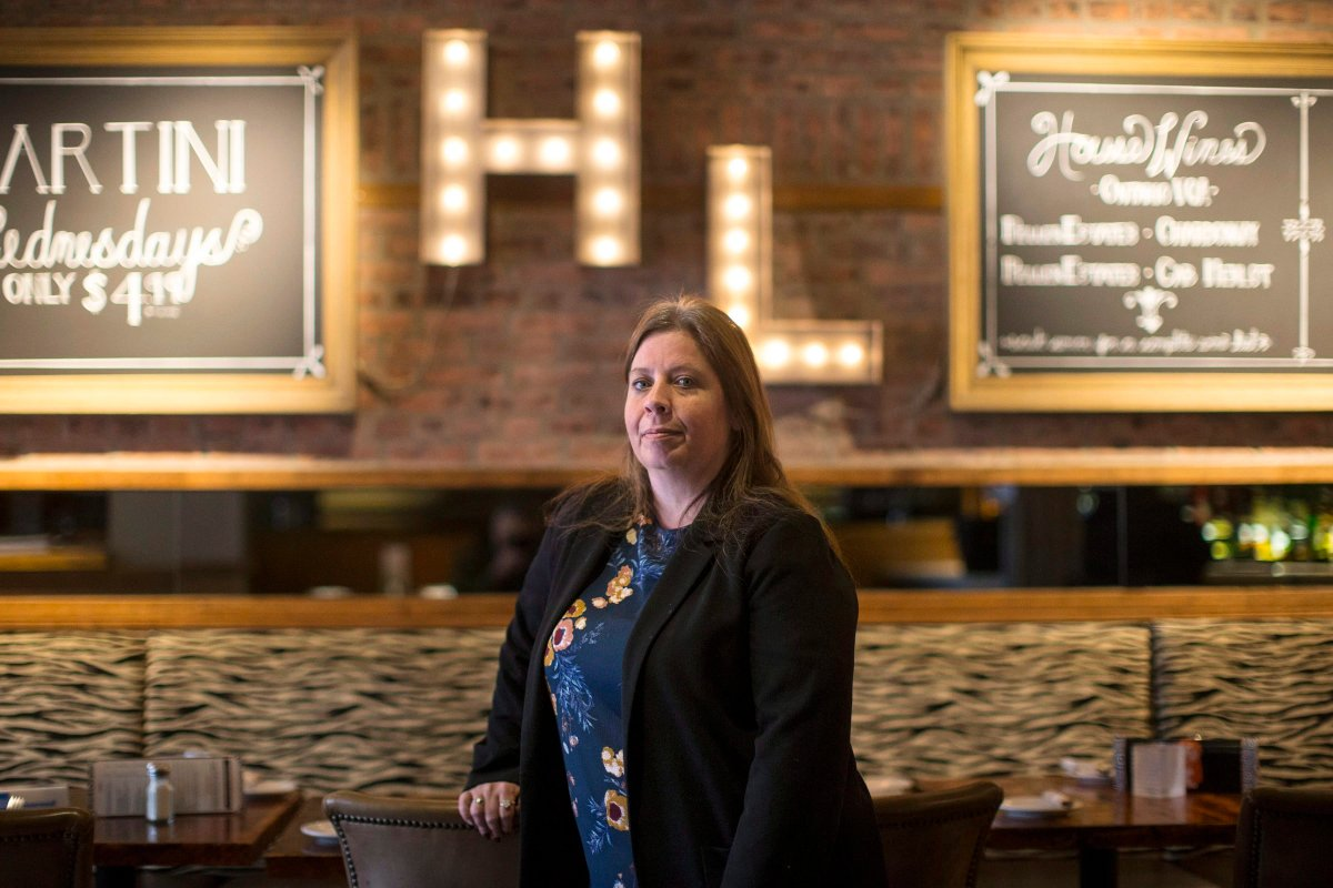 """Ginger Hunt, general manager of """"Hey Lucy,"""" is pictured in the restaurant in Toronto on Saturday, April 7, 2018. Hunt is trying to offer customers a more inclusive dining experience by encouraging servers to use gender-neutral greetings so not only """"ladies"""" and """"gents"""" feel welcome, but """"friends"""" across the gender spectrum."""