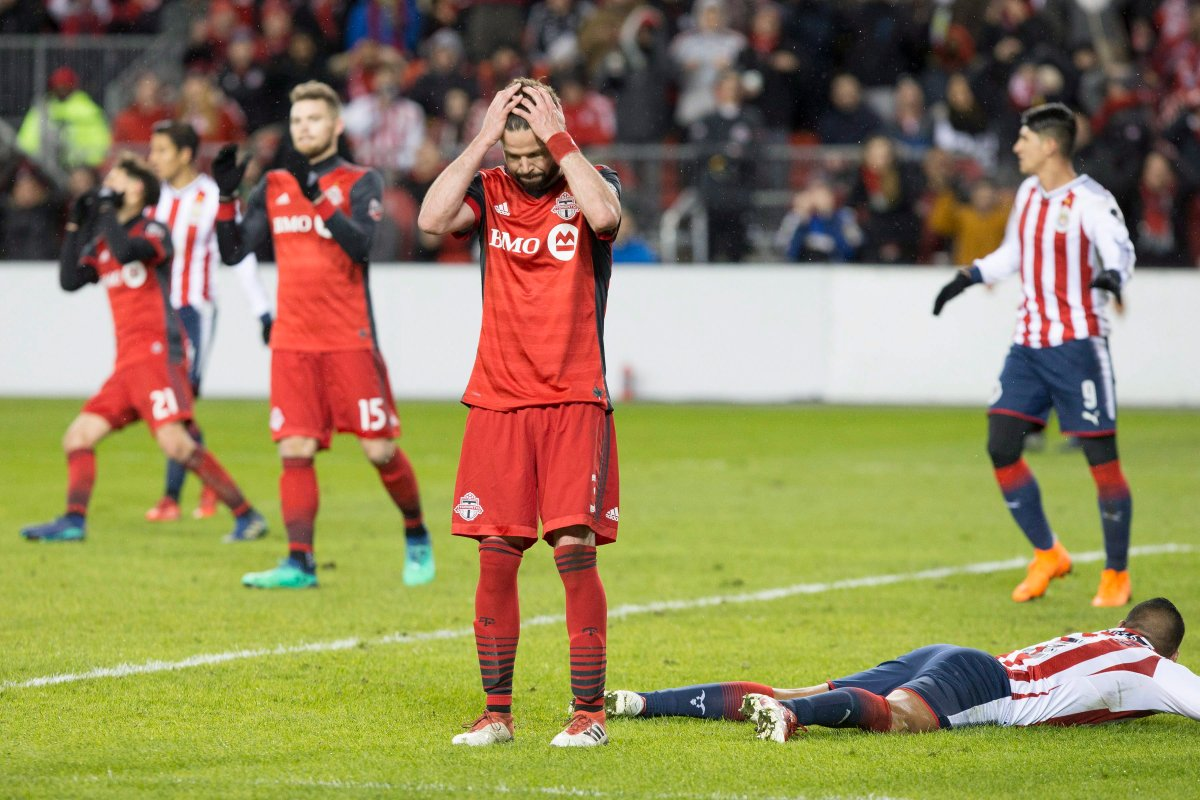 Toronto FC's Drew Moor reacts after missing a goal scoring chance during second half CONCACAF Champions League final first leg action against Chivas de Guadalajara, in Toronto on Tuesday, April 17, 2018.
