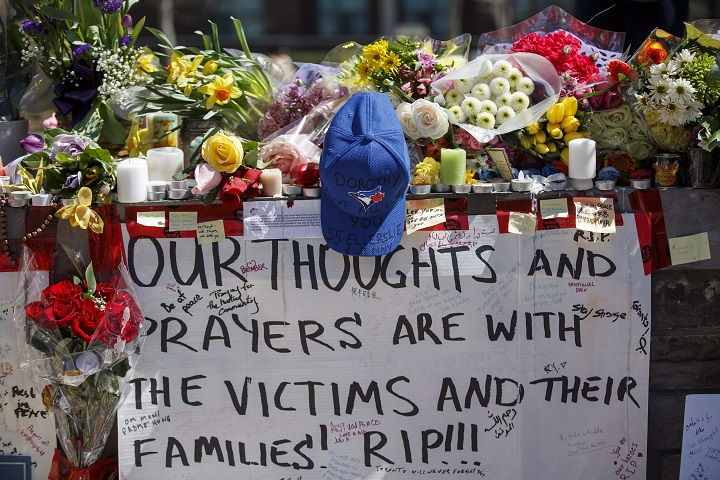 Tributes are seen on a memorial at Yonge St. and Finch Ave. in Toronto on Thursday, April 26, 2018 for the victims of Monday's deadly van attack.