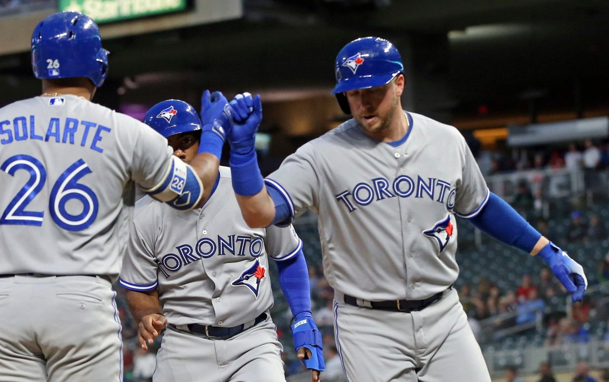 Toronto Blue Jays' Justin Smoak, right, is congratulated by Yangervis Solarte after Smoak's two-run home run off Minnesota Twins pitcher Lance Lynn in the fourth inning of a baseball game Monday, April 30, 2018, in Minneapolis.