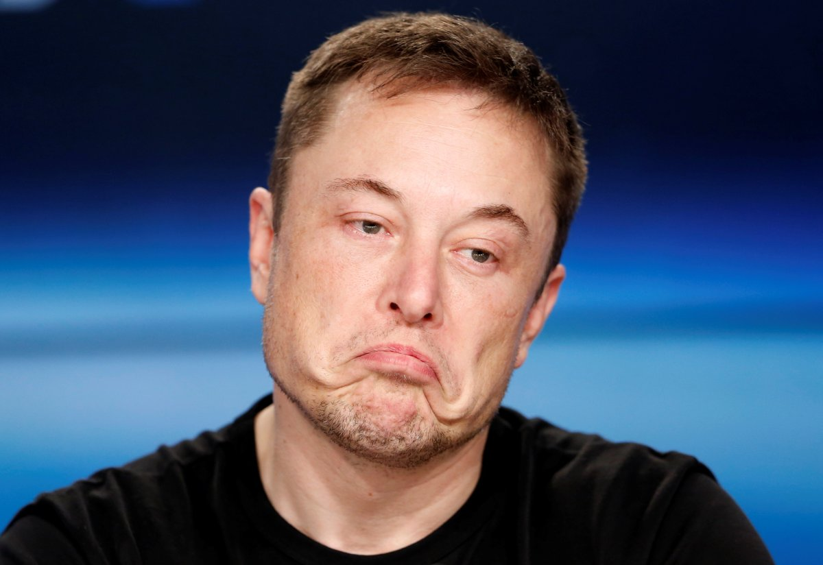 Tesla CEO Elon Musk said relying on too many robots caused some of the delays that have plagued the production of the Model 3 sedan.