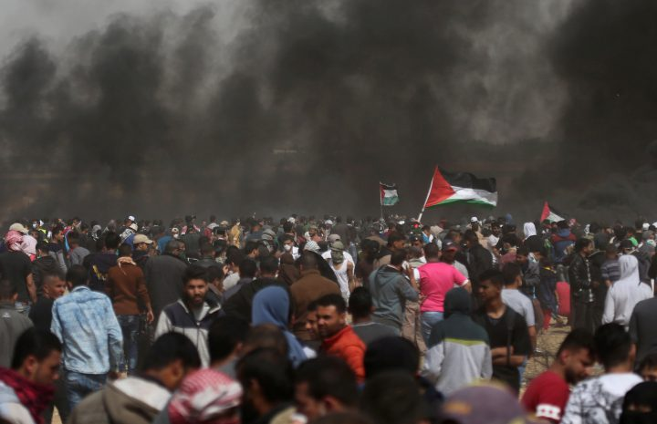 Palestinian demonstrators take part in a protest at the Israel-Gaza border on April 13.
