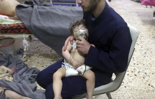 A medical worker gives a toddler oxygen after an alleged poison gas attack in the rebel-held town of Douma in eastern Ghouta, near Damascus, Syria, April 8, 2018. Chemical weapons investigators are being allowed access to the site 10 days after the gas attack.