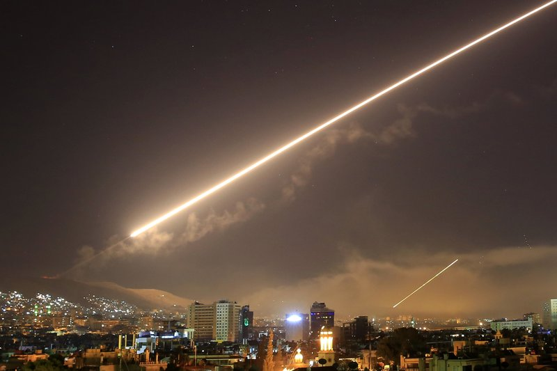 None Damascus skies erupt with surface to air missile fire as the U.S. launches an attack on Syria targeting different parts of the Syrian capital Damascus, Syria, early Saturday, April 14, 2018. Syria's capital has been rocked by loud explosions that lit up the sky with heavy smoke as U.S. President Donald Trump announced airstrikes in retaliation for the country's alleged use of chemical weapons.