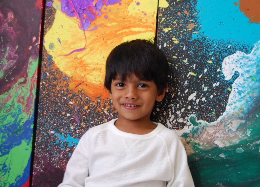 Advait Kolarkar, 4, is seen in this undated handout photo. When he's not playing with dinosaurs or reading a book, 4-year-old Advait Kolarkar uses paint, canvases and his imagination to create internationally-recognized abstract artwork. The preschooler is already selling his paintings for thousands of dollars and has had his art featured in three exhibits.