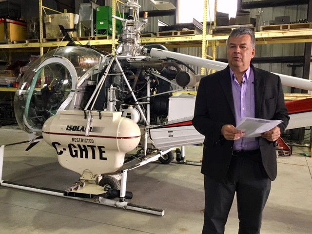 City of Winnipeg superintendent of insect control Ken Nawolsky, in front of one of four larviciding helicoptors.