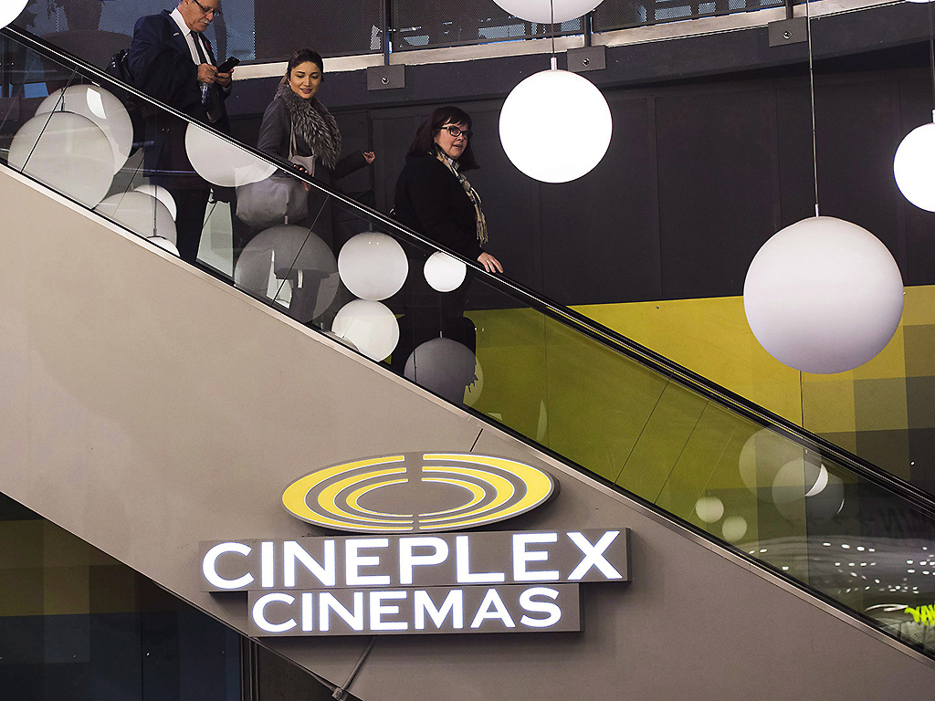 People leave a Cineplex theatre in Toronto on November 4, 2016.