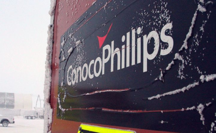 This Feb. 9, 2016, file photo shows an ice-covered ConocoPhillips sign at the Colville-Delta 5, or as it's more commonly known, CD5, drilling site on Alaska's North Slope. ConocoPhillips reports financial results Thursday, April 28, 2016.