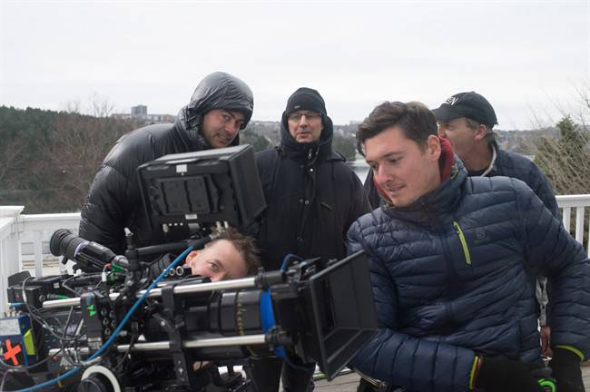 FILE - Halifax-based camera operator Andrew Stretch, right in blue jacket, and other crew on the set of Haven, a supernatural drama filmed in Nova Scotia.