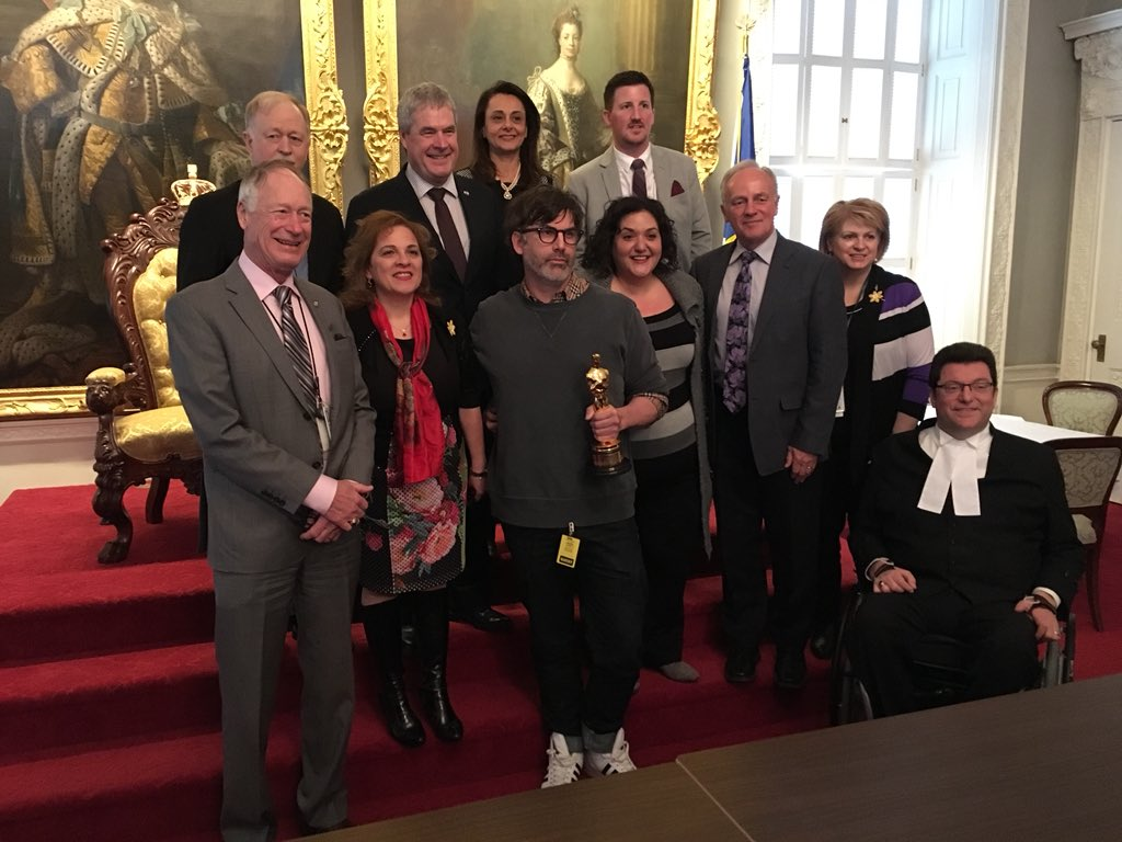 Shane Vieau, who won an Academy Award for his set design on The Shape of Water, poses with MLAs at the Nova Scotia legislature on April 4, 2019.