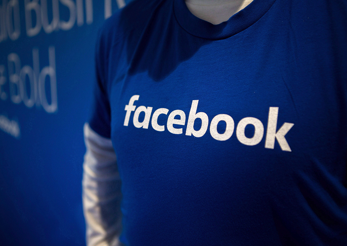 Guest are welcomed by people in Facebook shirts as they arrive at the Facebook Canadian Summit in Toronto on Wednesday, March 28, 2018.