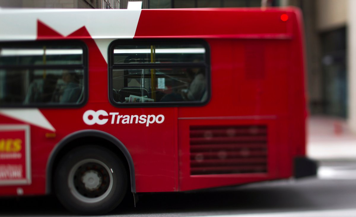 An OC Transpo bus drives down the street in this photo taken with a tilt shift lens in Ottawa, Ontario, Canada, on Tuesday, Aug. 9, 2011 .
