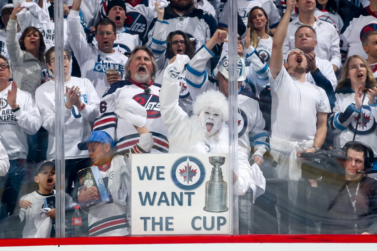 Jets fans clad in white cheer wildly during Game Five, First Round of the 2018 NHL Stanley Cup Playoffs at the Bell MTS Place.