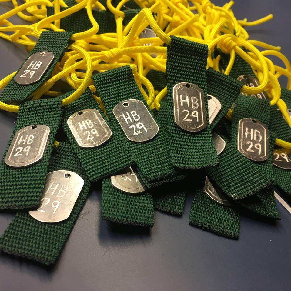 Green and yellow zip tags are being sold for $5.00 each in support of the Humboldt Broncos.
