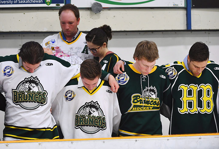 Mourners embrace each other during a moment of prayer at a vigil at the Elgar Petersen Arena, home of the Humboldt Broncos, to honour the victims of a fatal bus accident, April 8, 2018.