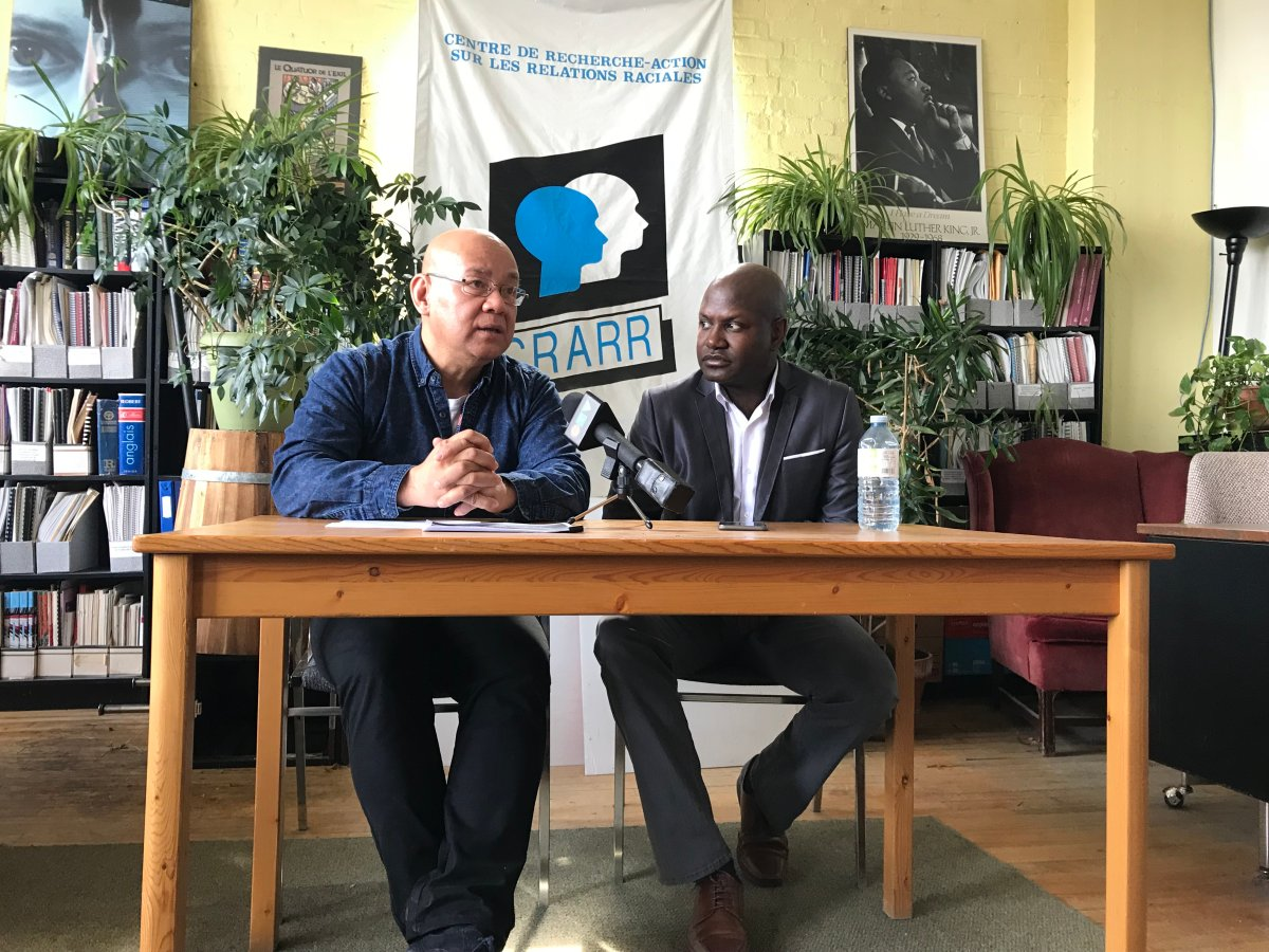 CRARR executive director Fo Niemi and resident Joel DeBellefeuille at a press conference on Tuesday, April 24, 2018.
