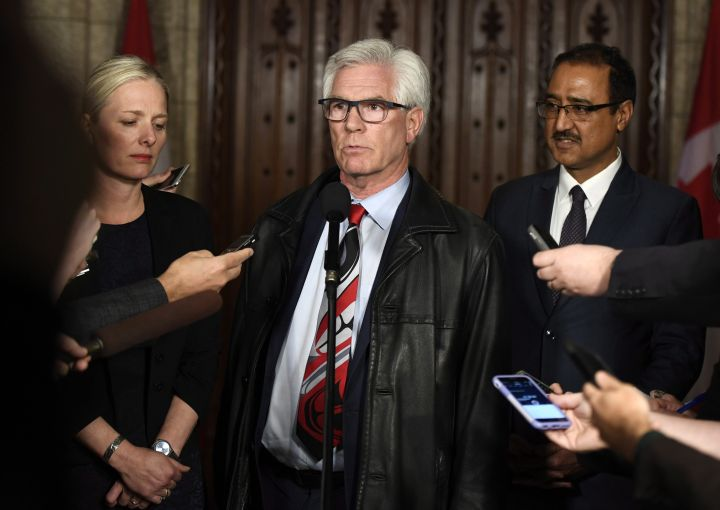 Minister of Natural Resources Jim Carr speaks to reporters with Minister of Environment and Climate Change Catherine McKenna and Minister of Infrastructure and Communities Amarjeet Sohi, after an emergency cabinet meeting on Parliament Hill in Ottawa on Tuesday, April 10, 2018.