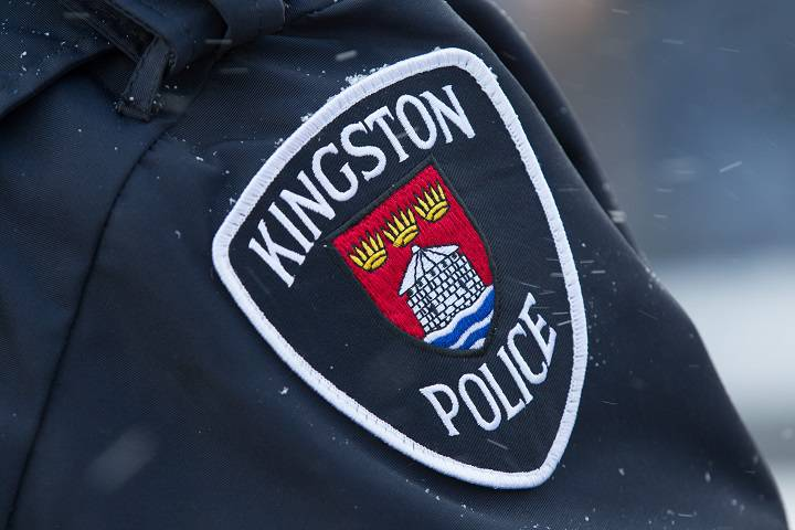 Kingston police say a man was caught naked allegedly masturbating behind a Queen Street address.