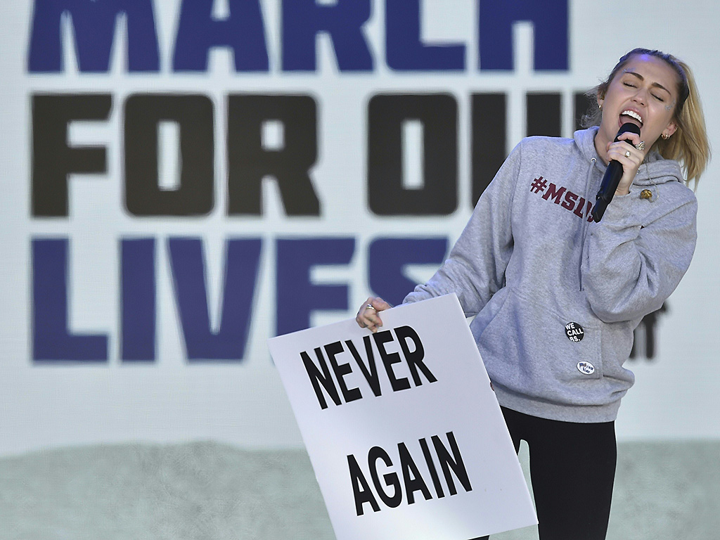 Miley Cyrus sings during the March for Our Lives Rally in Washington, DC on March 24, 2018.