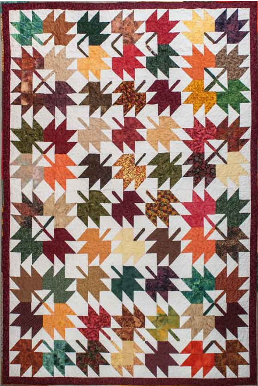 This photo shows suitable cotton fabrics for Quilts of Valour sewn in a maple leaf pattern,.