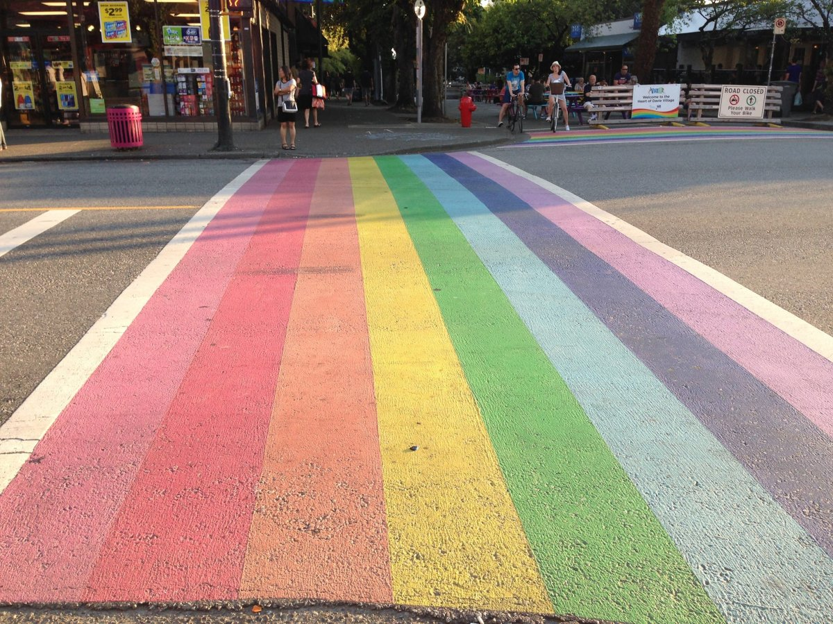 FILE - A rainbow crosswalk in Vancouver at the corner of Davie and Bute Streets is shown in this file photo. The Logy Bay-Middle Cove-Outer Cove town council in Newfoundland voted Tuesday evening to create two brightly-coloured crosswalks in the community of about 2,000 people.