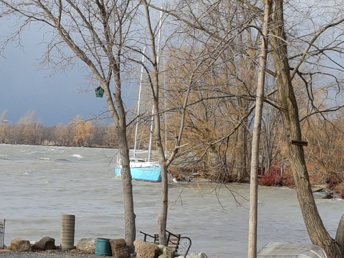 A sailboat being tested for the Northwest Passage has been detached from its moorings off of Wolfe Island due to high winds.