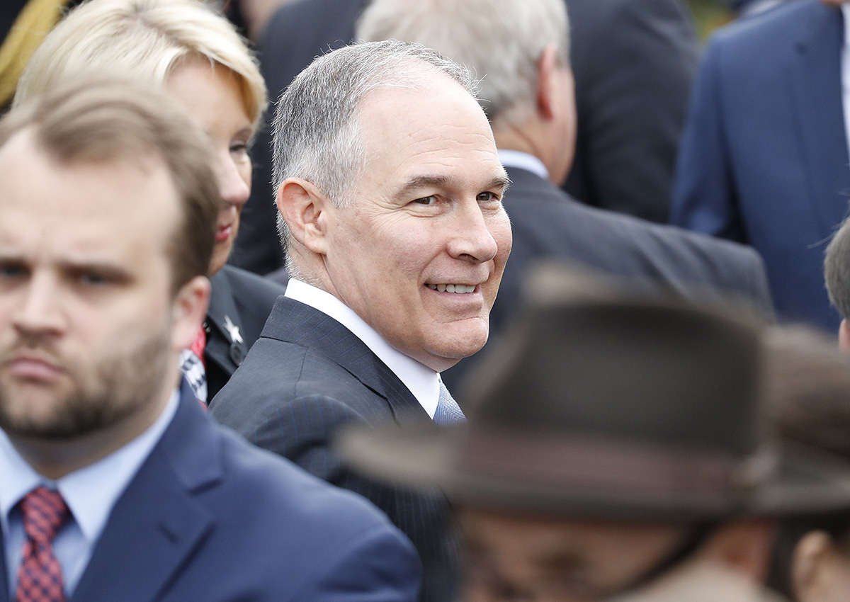 EPA chief Scott Pruitt waits on the South Lawn of the White House.