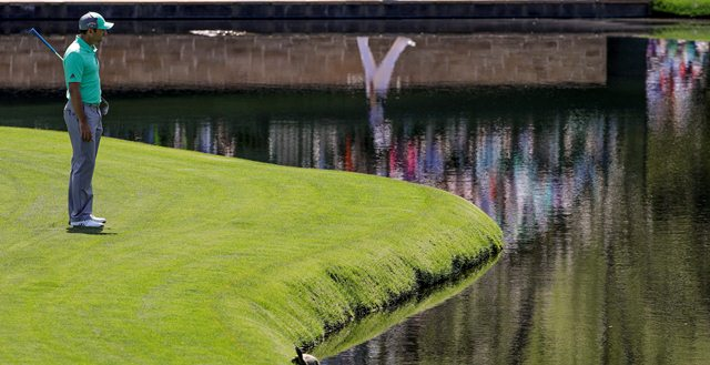 Sergio Garcia, of Spain, looks over the water on the 15th hole during the first round at the Masters golf tournament Thursday, April 5, 2018, in Augusta, Ga. Garcia shot an 8-over 13 on the hole.