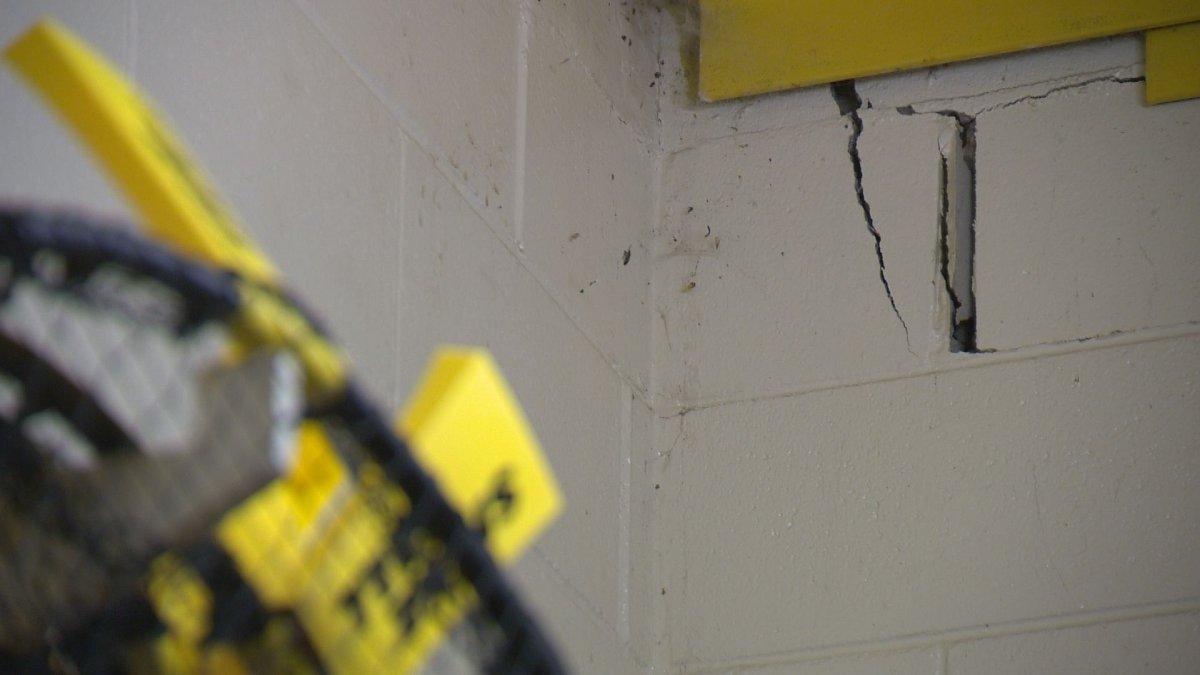 Significant cracks in the bricks inside Ecole St. Pius' gymnasium equipment room.