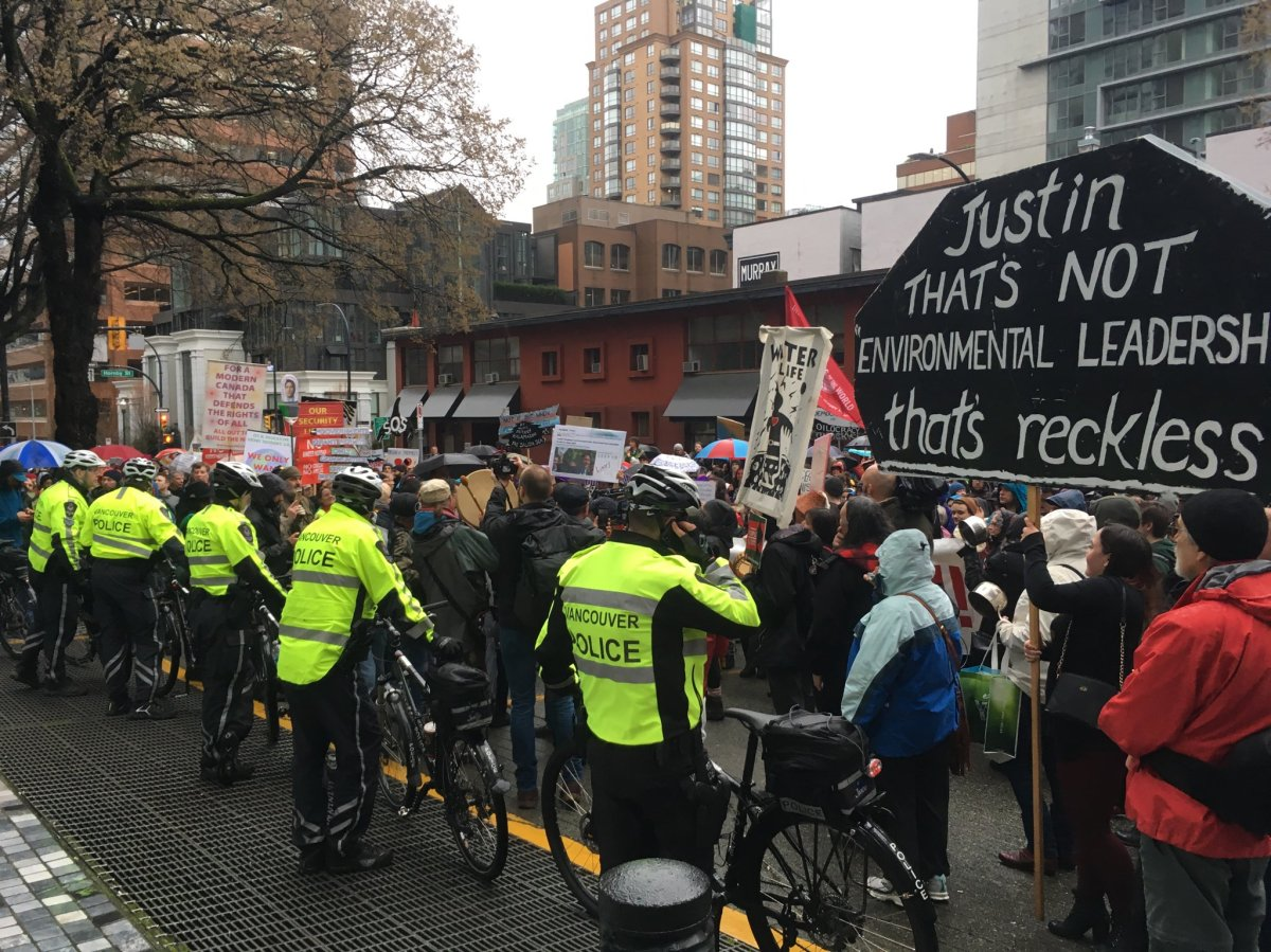 The scene outside the Sheraton Wall Centre in Vancouver as protesters demonstrated against Prime Minister Justin Trudeau and his decision to allow the expansion of Kinder Morgan's Trans Mountain pipeline on April 5, 2018.