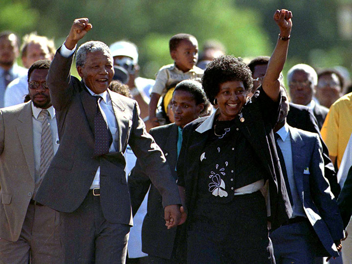 Nelson Mandela is accompanied by his then-wife Winnie moments after his release from prison near Paarl, South Africa, Feb. 11, 1990.