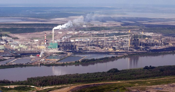 The Suncor mine facility along the Athabasca river as seen from a helicopter.