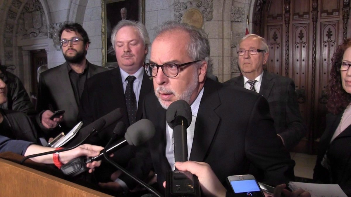 In this framegrab from video, Bloc Quebecois MP Rheal Fortin announces he is quitting the party caucus in Ottawa, Wednesday, Feb.28, 2018.