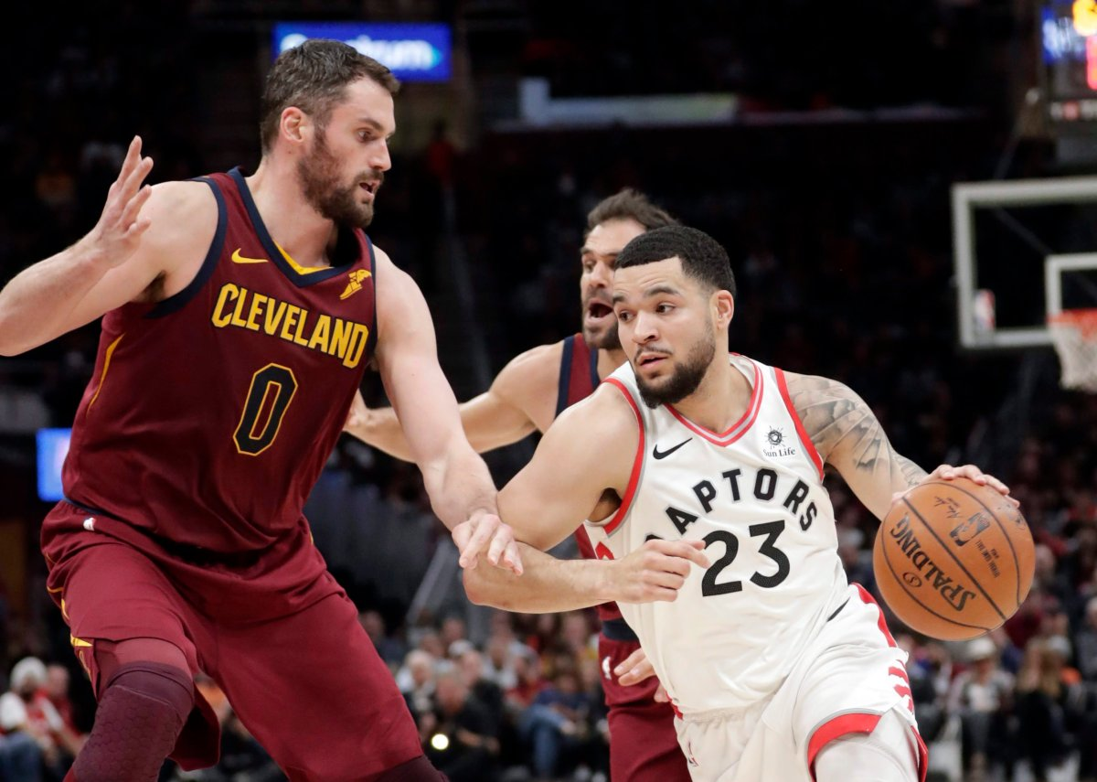 Toronto Raptors' Fred VanVleet (23) drives against Cleveland Cavaliers' Kevin Love (0) during the first half of an NBA basketball game Wednesday, March 21, 2018, in Cleveland.